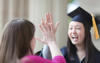 Congratulating-High-Five-with-Graduating-Student-in-Graduation-Ceremony-000039912072_Double_small