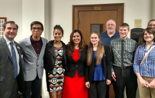 St. Vrain students pose for a photo with Majority Leader Duran after the committee meeting.