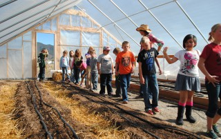 Students visit the Salida School Gardens. Source: Guidestonecolorado.org