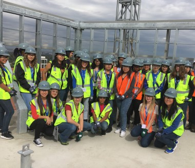 27 Denver high school girls tour a JE Dunn Construction site in Denver as part of their </p srcset=