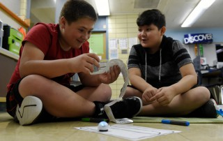 ENGLEWOOD, CO - SEPTEMBER 6: Jayce Prante, left, and Gage Luna read an instruction manual as they discover different color patterns to make their Ozobot perform different tasks at Bishop Elementary School on September 6, 2017, in Englewood, Colorado. Englewood Schools built STEM labs in all of its elementary schools during the summer with the support of the Gill Foundation. (Photo by Seth McConnell/The Denver Post)