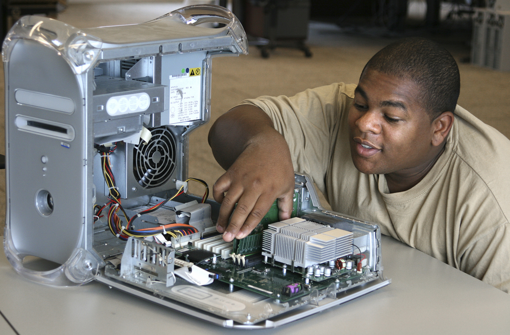 Afro-americcanIT-Professional-installs-memory-in-a-Computer-000003606386_Large