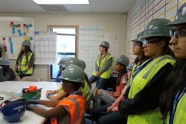 27 Denver high school girls tour JE Dunn's Denver construction site as part of their girls in STEM initiative.