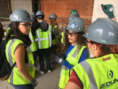 Denver high school girls tour JE Dunn's Denver construction site as part of their girls in STEM initiative.