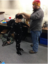 Wybrant works with an elementary student on motion capture technology. Source: PHS Talon Studios